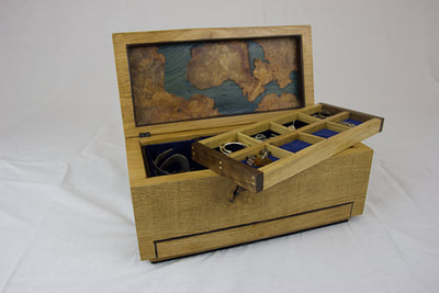 Insert tray with divisions inside solid oak jewellery box by Reuben's woodcraft.