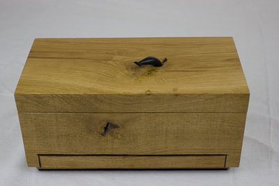 Top and front of solid oak block jewellery box by Reuben's woodcraft